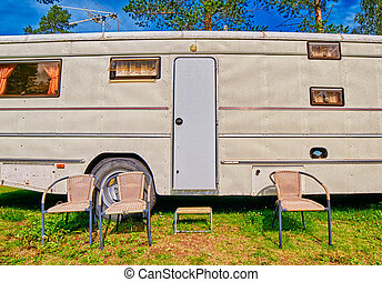 Big Old American RV Camping Car in Pine Forest Setting