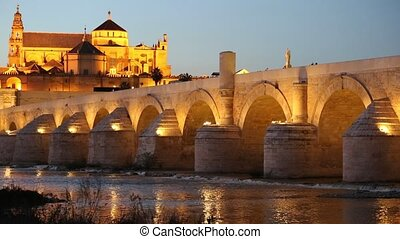 Cordoba, Spain cityscape at the Roman Bridge and...