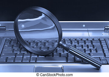 Laptop Magnifying glass - Laptop with a magnifying glass,...