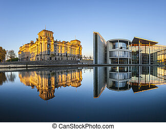 Reichstag with reflection in Spree, Berlin - Reichstag with...