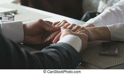 Men hands stroking the girls hand tenderly - The man holding...