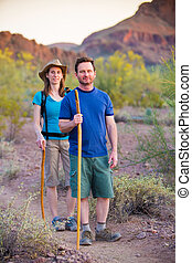 Desert Hikers on Path