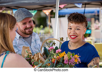 Couple Purchases Flowers at Famers Market - Attractive...