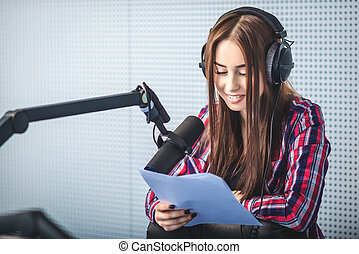 dj working on the radio - female dj working in front of a...