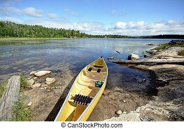 Canoe on the Shore of Wilderness Lake - Kevlar Canoe on the...