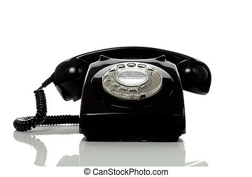Retro black phone - Retro black telephone on a white surface...