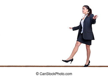 Businesswoman walking a tightrope isolated on white. -...