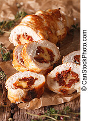 Chicken roll with cheese and sundried tomatoes close-up...
