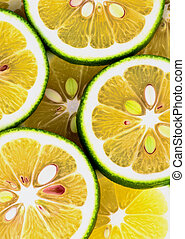 Green Lemons Background - Fresh Ripe Sliced Green Lemons...