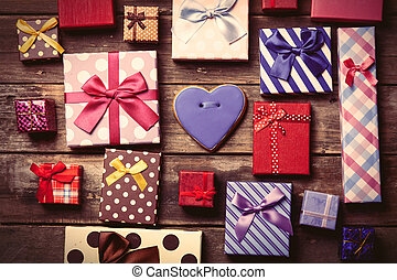colorful gifts and cookie on the table - colorful gifts and...