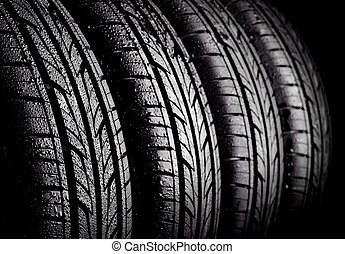 Tyres - Car wet tyres on a black background.