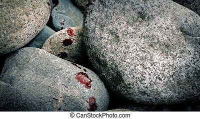 Blood Spatters Across Rocks - Red blood spatters on rocks,...