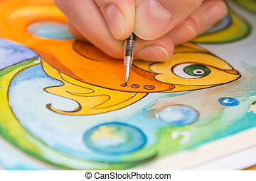 Close-up of the process of drawing goldfish