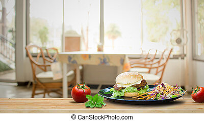 Burger on the wooden table with Blurred of dining room.
