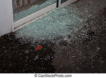 Break in - Sliding glass door that has been shattered as a...