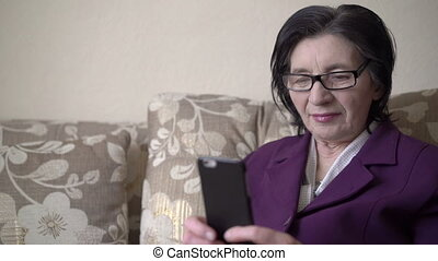 Business woman in her 70s and lifestyle technology. Full HD