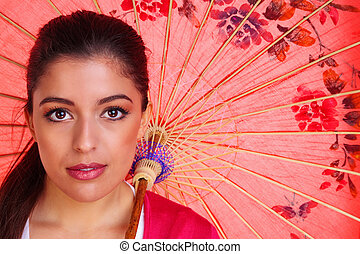 Brunette woman woth chinese umbrella