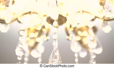 Gold chandelier on a white background. Slow motion.