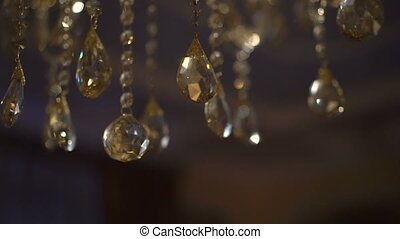 Luxury crystals of a classic chandelier on a dark...