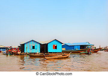 Houseboats in floating village, Tonle Sap lake, Cambodia -...