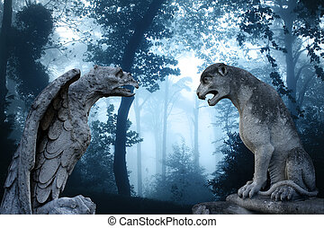 Ancient eagle and lion statues in misty forest - Ancient...