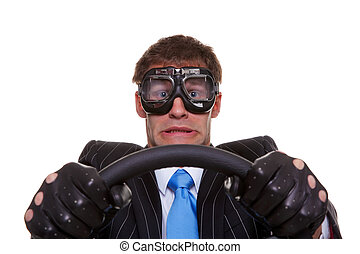 Scared driver - Businessman in driving gloves and goggles...