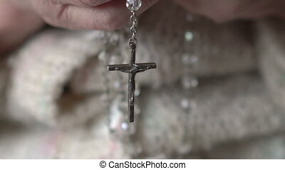 Closeup crucifix, crystal rosary in old hands  full HD