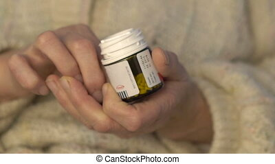 Closeup old worn hands holding and using drug full HD