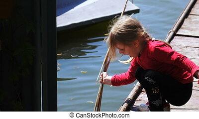 Little girl on riverside