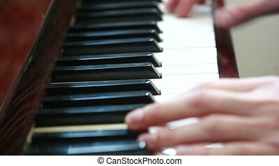 Playing piano. man playing piano - Playing piano. Close-up...