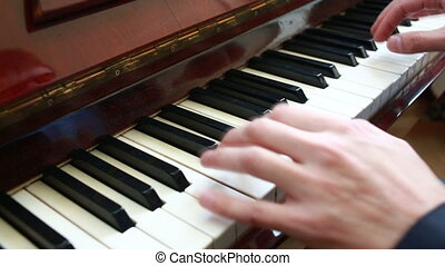 Playing piano man playing piano - Playing piano Close-up top...