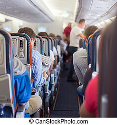 Passengers on commercial airplane - Interior of airplane...
