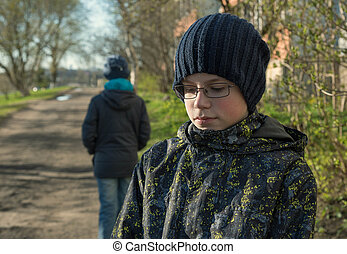 conflict and emotional stress in young teens couple relationship outdoors