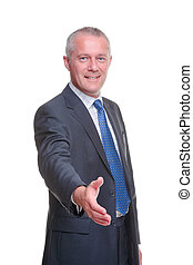 Businessman hand shake - A mature businessman offering to...