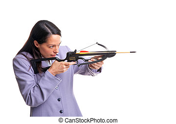 Businesswoman shooting a crossbow - Businesswoman in a suit...