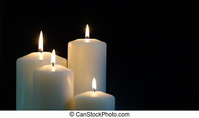 footage burning candles isolated on a black background Hd...