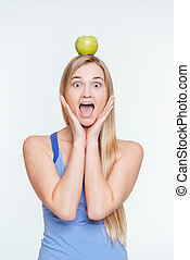 Funny woman with apple on head