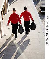 Taking out the garbage - Two men taking out the garbage