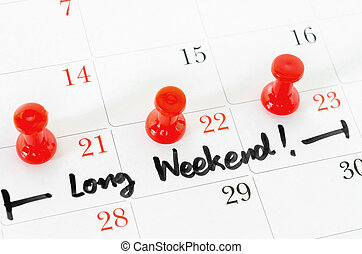 The words Long Weekend written on a white - Concept image of...