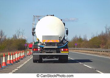 Fuel tanker on dual carriageway - Rear view of a fuel tanker...