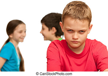 Difficult relations - A sad boy is disappointed because of...