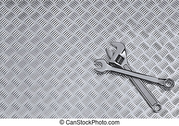 Checkerplate and wrenches background - Mechanical background...