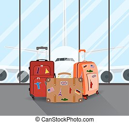 Travel suitcases in airport with a plane in background...