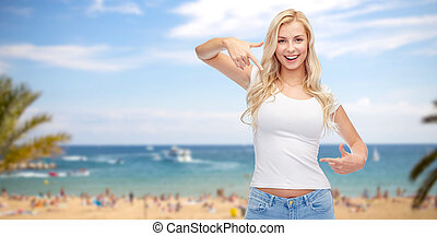 happy young woman or teenage girl in white t-shirt -...