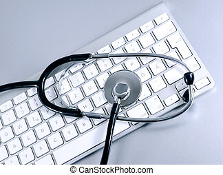 IT support - Computer keyboard and medical stethoscope,...
