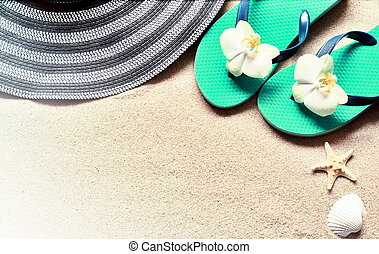 Flip Flops in the sand with starfish . Summertime .beach concept.