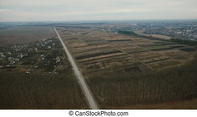 Aerial view: Ukrainian fields and houses, roads and pool,...