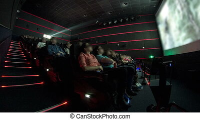viewers watch motion picture at movie theatre timelapse -...