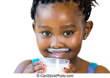 Face shot of sweet african girl with milk mustache. - Close...