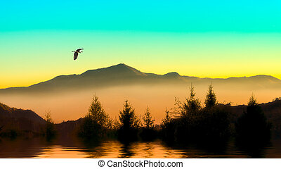 Heron in the mountains in a warm colored sky